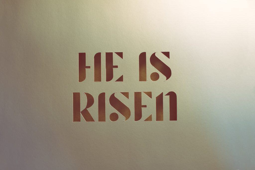 A sign that says 'He is Risen'