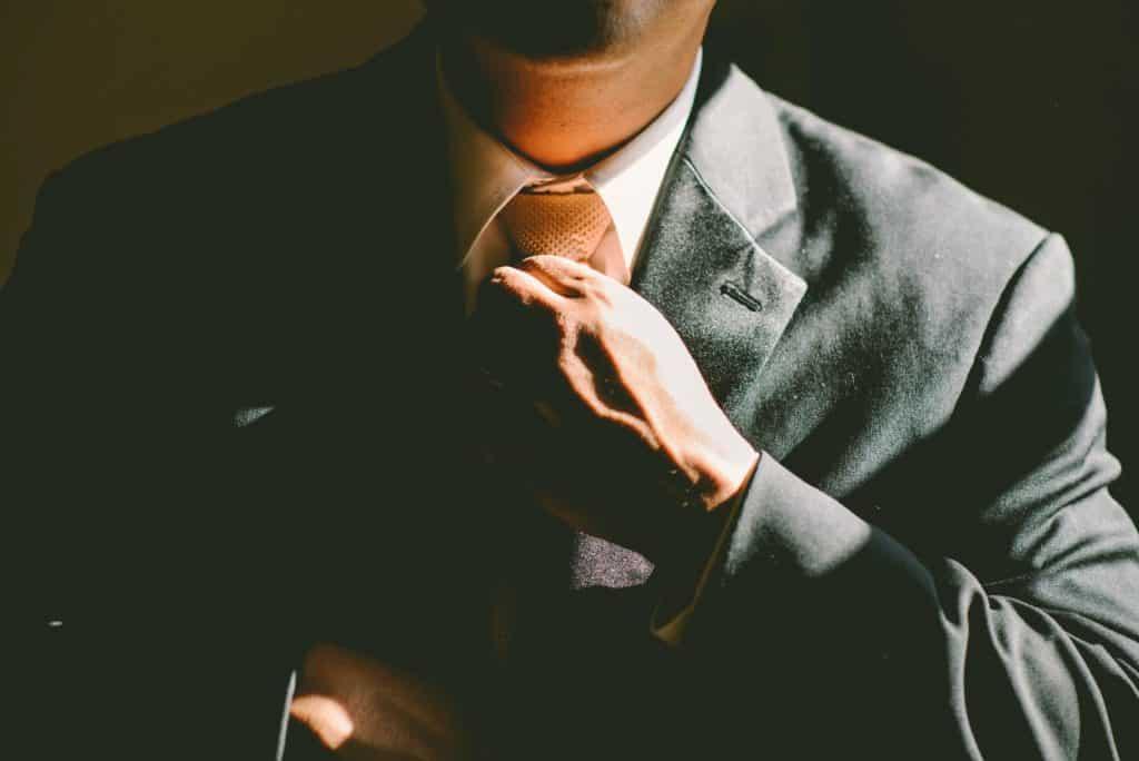 A man straightening his tie.