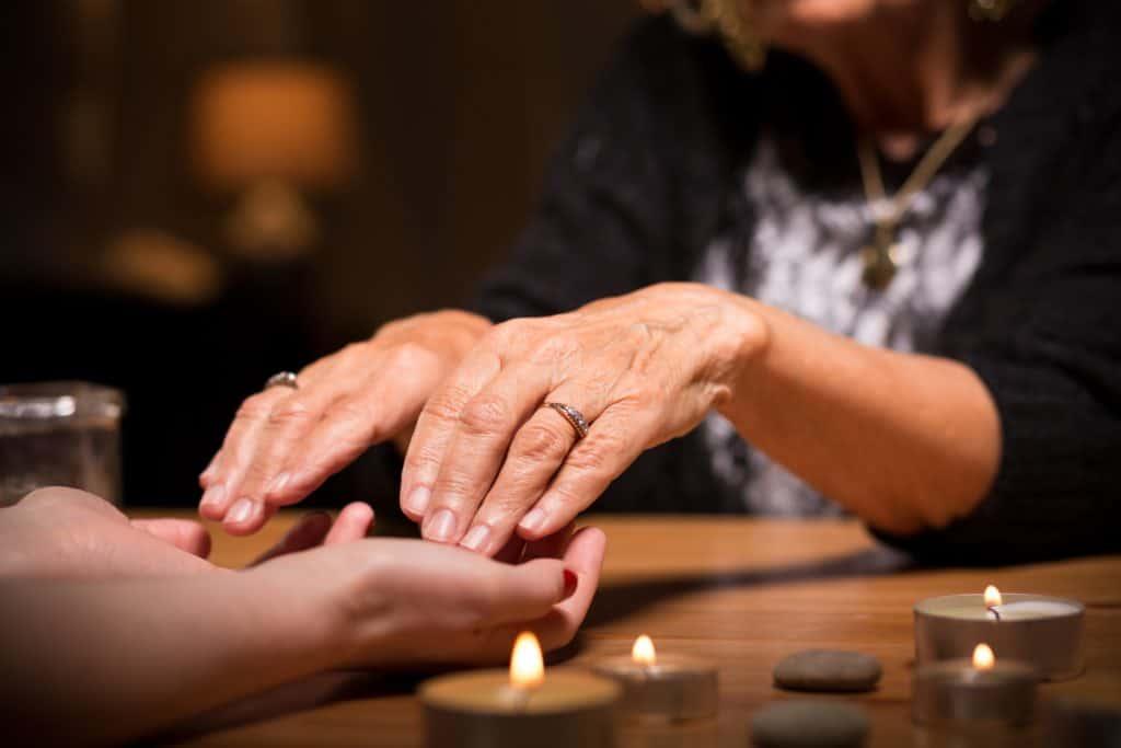 Close-up of spiritualistic seance in fortune telling salon