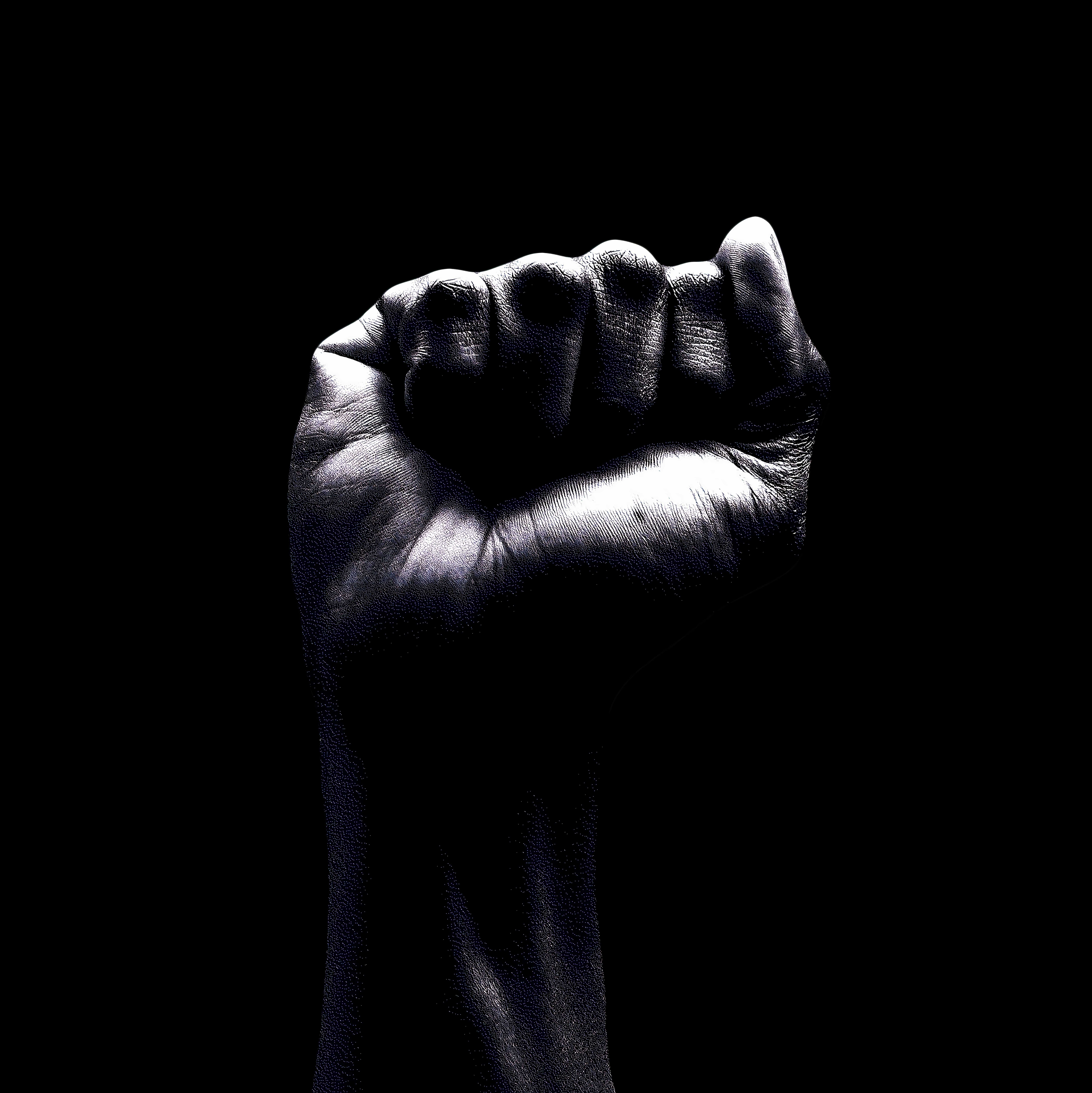 A fist in front of a black background.