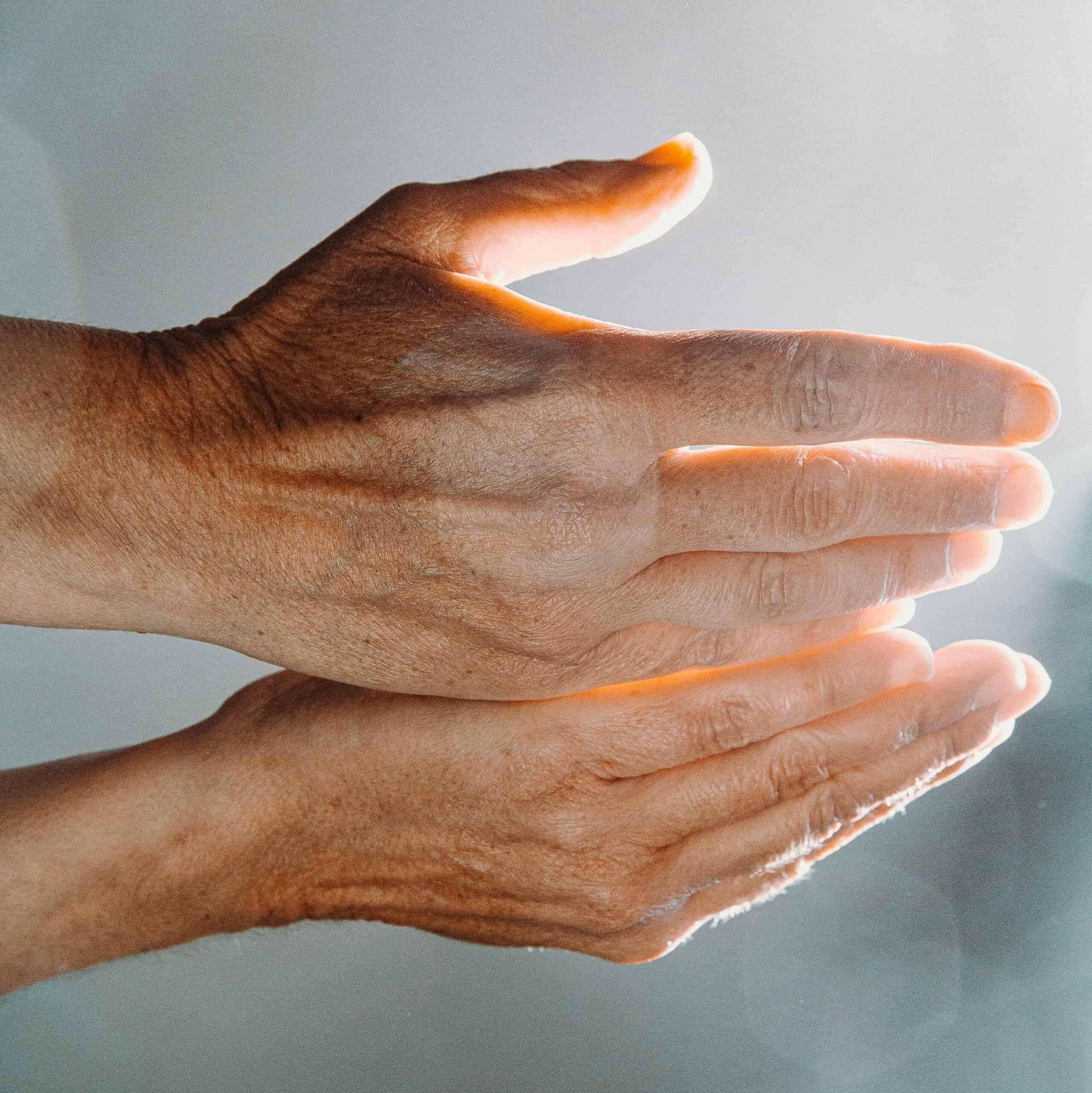 A person holding out cupped hands.